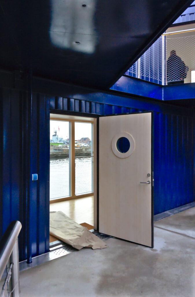 Urban Rigger 2.0 by BIG entrance door